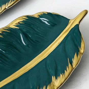 Зелена порцеланова чиния във формата на листо