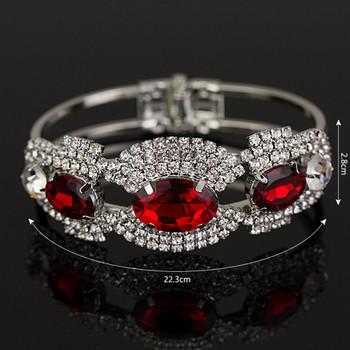 Елегантна дамска гривна със сребристи и червени камъни