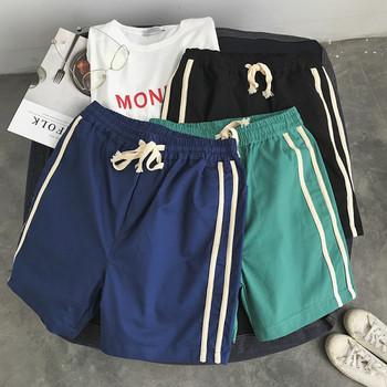Къси мъжки спортни панталони с кант