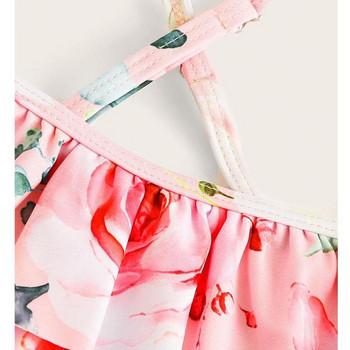 Актуален розов бански от две части за момичета с кръстосани презрамки и флорални мотиви