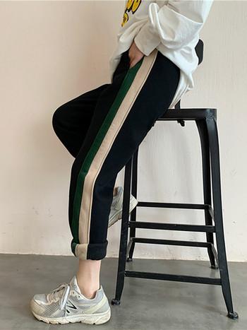 Дамски спортен панталон с еластична талия и цветни кантове