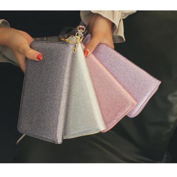 Γυναικείο μοντέρνο πορτοφόλι με λαβή