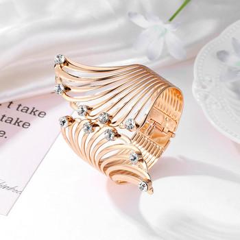 Златист пръстен с декорация камъни