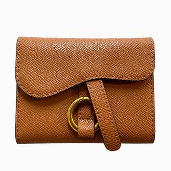 Γυναικείο πορτοφόλι από οικολογικό δέρμα με μεταλλική διακόσμηση