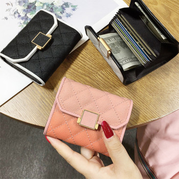 Μοντέρνο γυναικείο πορτοφόλι από οικολογικό δέρμα με μεταλλική στερέωση