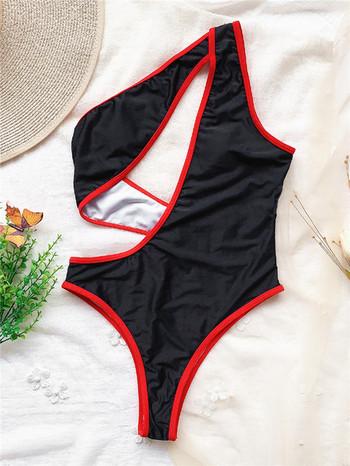 Цял бански костюм с изрязана част в черен цвят