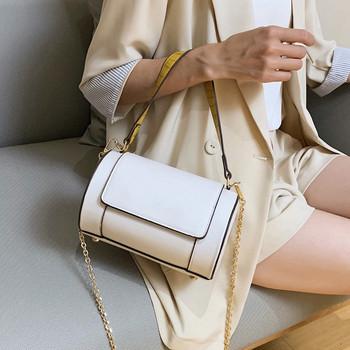 Τρέχουσα γυναικεία τσάντα σε στρογγυλό σχήμα με μεταλλική λαβή