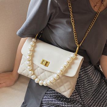 Κομψή γυναικεία τσάντα από οικολογικό δέρμα με διακοσμητικές πέρλες