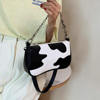 Γυναικεία τσάντα με μεταλλική λαβή από οικολογικό δέρμα