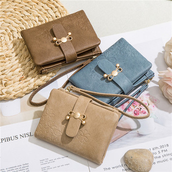 Γυναικείο πορτοφόλι από οικολογικό δέρμα με μεταλλικό στοιχείο και φερμουάρ