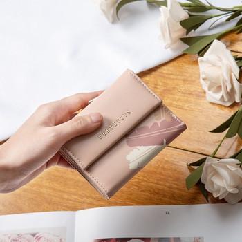 Γυναικείο μικρό πορτοφόλι με μεταλλικό κούμπωμα και τσέπη με κέρματα