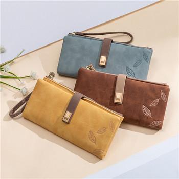 Γυναικείο πορτοφόλι με μεταλλική στερέωση και φερμουάρ
