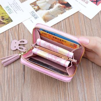 Γυναικείο μικρό πορτοφόλι με μεταλλικό στοιχείο και φερμουάρ