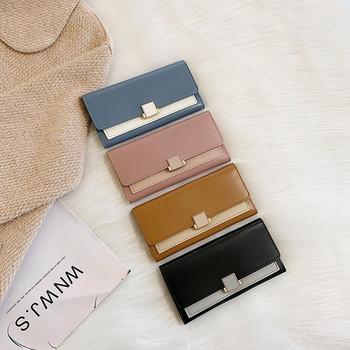 Κομψό γυναικείο πορτοφόλι από οικολογικό δέρμα με μεταλλικό στοιχείο