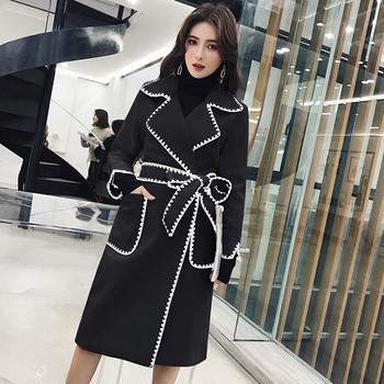 Модерно вталено палто с колан и джобове